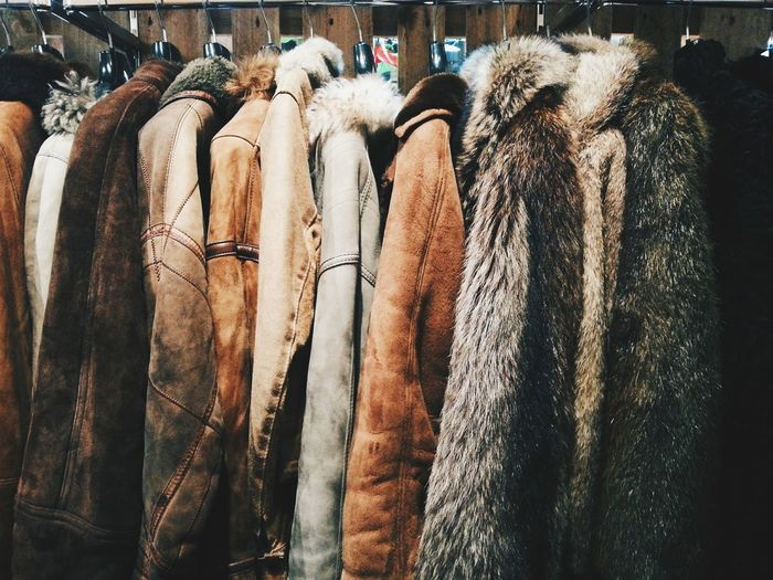 Close-Up Side View Of Jackets On Rack