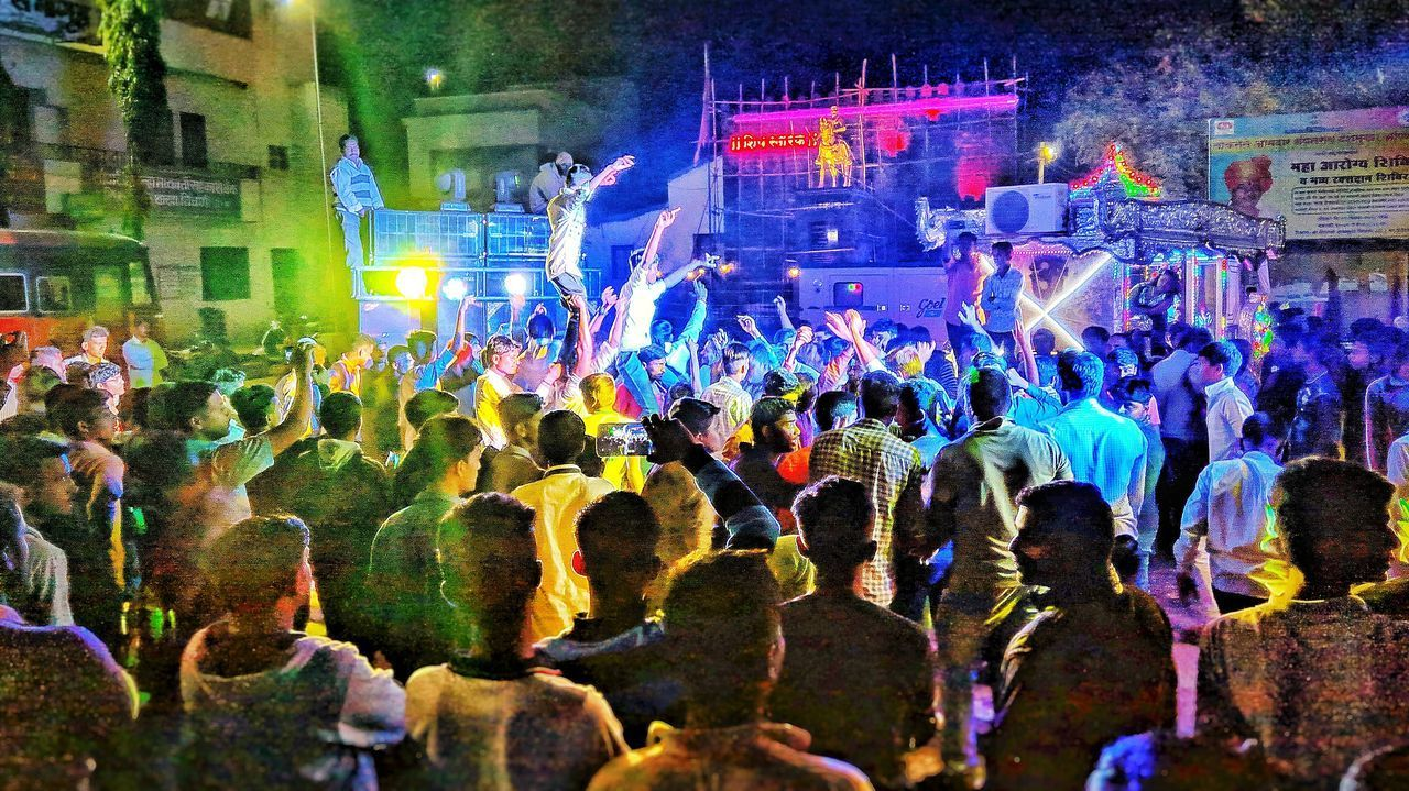 crowd, large group of people, group of people, real people, illuminated, night, nightlife, arts culture and entertainment, music, men, nightclub, event, enjoyment, dancing, performance, women, adult, architecture, motion, arms raised, clubbing, human arm, stage, excitement, light, disco dancing