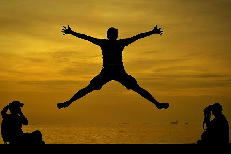 Silhouette of man jumping