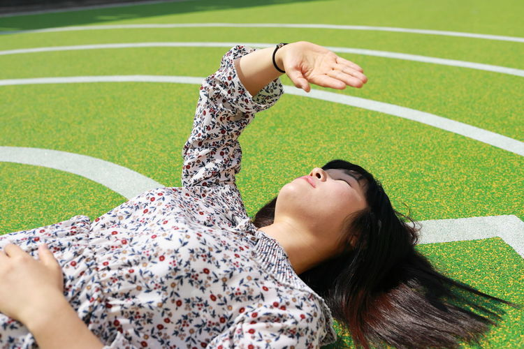 My Best Photo Exploring Fun Enjoying Life One Person Leisure Activity Lying Down Women Casual Clothing Outdoors Green Color Arms Raised Human Arm Human Body Part Fashion Playground Abstract Lifestyles People Portrait Females Light And Shadow Sunny Sunlight
