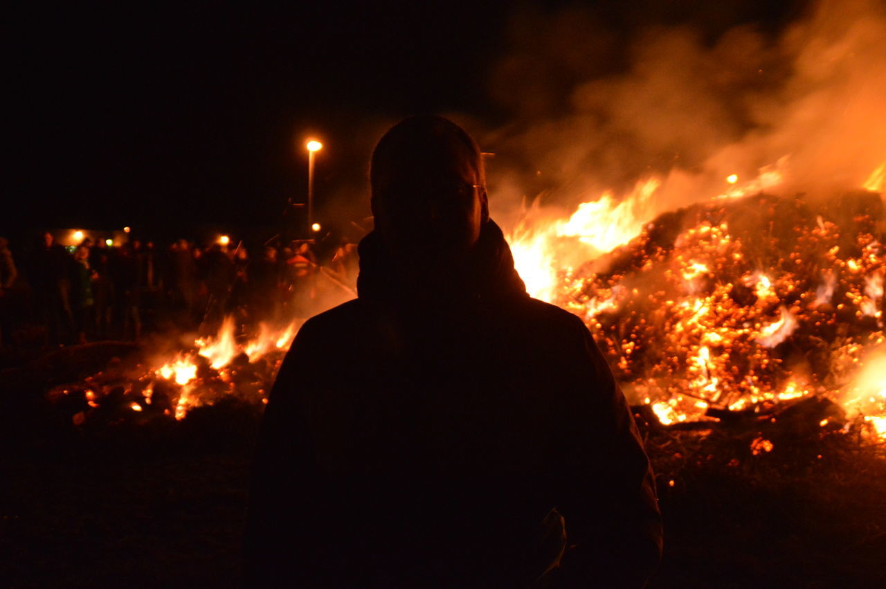 Man Standing Against Fire During Easter
