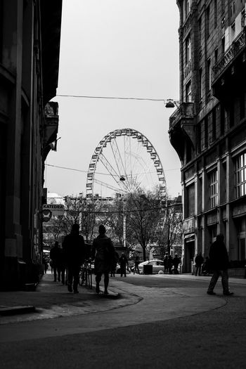 Camera - Canon 550D - Lens - 50 mm f/1.8 Blog : https://www.instagram.com/david_sarkisov_photography/ Architecture Building Exterior Built Structure City Amusement Park Ride Ferris Wheel Amusement Park Domestic Animals Street Domestic Building Mammal Real People Day Men Group Of People Women Pets Outdoors Blackandwhite Black And White Streetphotography Ubran City Travel Streetwise Photography