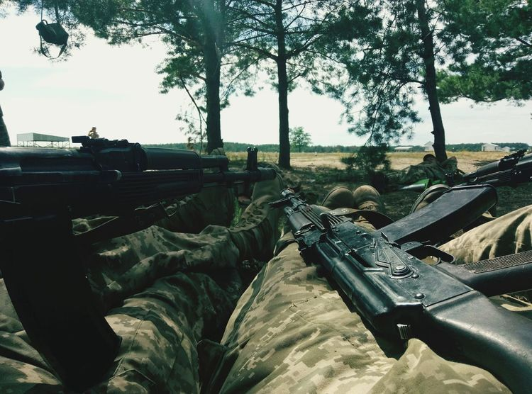 Army Life Weapons Of War Sky Outdoors Army Day Cannon Gun War Weapon Military Men Army Soldier People Bullets Nature Tree