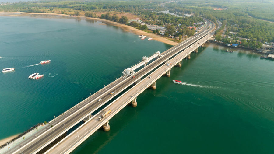 High angle view of bridge over sea in city