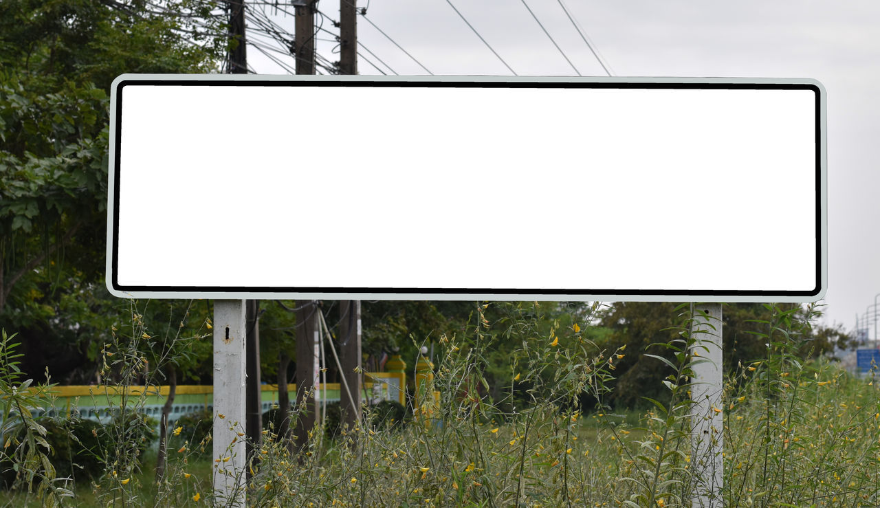plant, tree, communication, blank, no people, technology, nature, screen, copy space, day, outdoors, billboard, device screen, empty, advertisement, sign, land, sky, connection, road, message, flat screen, marketing, electrical equipment