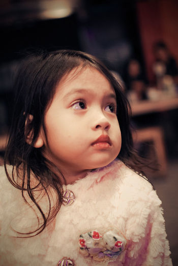 pensive mood Headshot Portrait Childhood Child Innocence Females Focus On Foreground Indoors  Looking Girls Hair Looking Away One Person Black Hair Casual Clothing Cute Close-up Hairstyle Women Offspring Contemplation