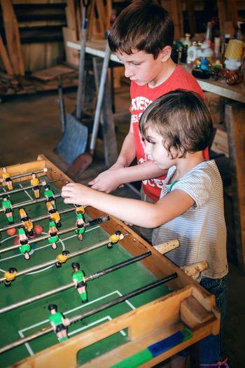 High angle view of boys playing foosball