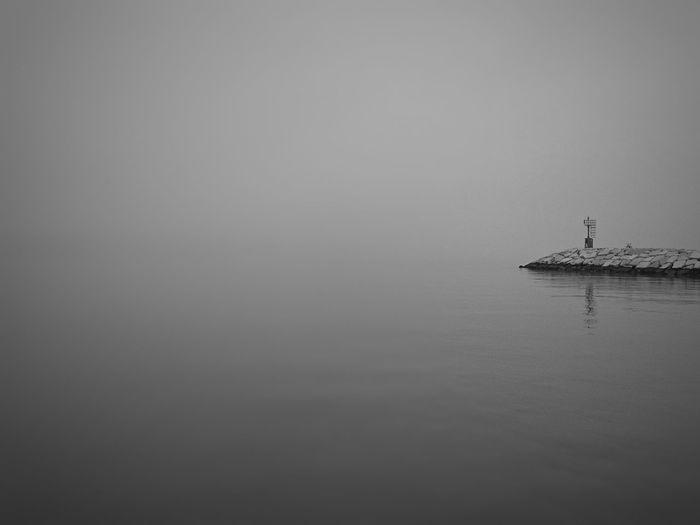 Horizon disappeared Blackandwhite Photography Horizon EyeEmNewHere EyeEm Best Shots EyeEm Selects Sea And Sky Sea Life Rowing Nautical Vessel Water Oar Silhouette Copy Space Sailing Foggy
