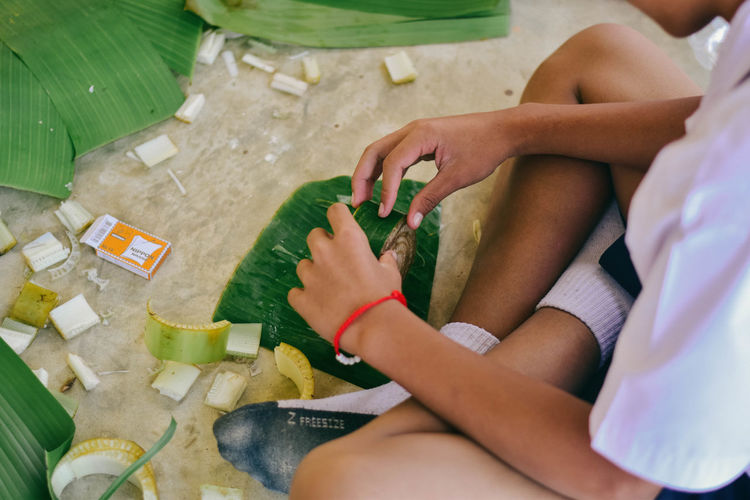 Low section of boy doing craft on floor