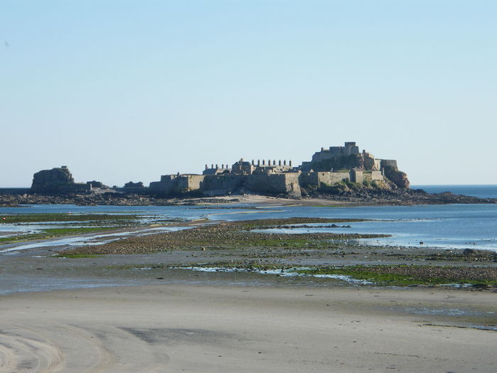 Elizabeth Castle, Jersey St Helier Architecture Beach Beauty In Nature Building Exterior Clear Sky Copy Space Day Nature No People Outdoors Sand Scenics Sea Shore Sky Travel Destinations Water Wave