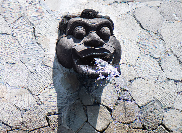 Close-up of fountain against wall