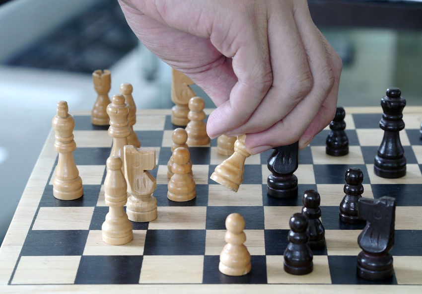 chess Board Game Chess Chess Board Chess Piece Close-up Competition Day Human Body Part Human Hand Indoors  Intelligence King - Chess Piece Knight - Chess Piece Leisure Activity Leisure Games One Person Pawn - Chess Piece People Playing Queen - Chess Piece Strategy