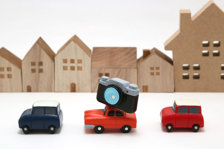 Close-up of toy car against building