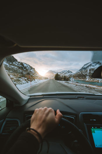 early morning rides through Lofoten. find more travel inspiration at http://www.instagram.com/simonmigaj Lifestyle Direction Travel Photography Road Man Moody Mood Dawn Sunrise Adventure View Norway Winter Snow Driving Steering Vehicle Interior Transportation Car Interior Car Human Hand Dashboard Driving Travel Windshield Journey Human Body Part Steering Wheel Winter Road Trip