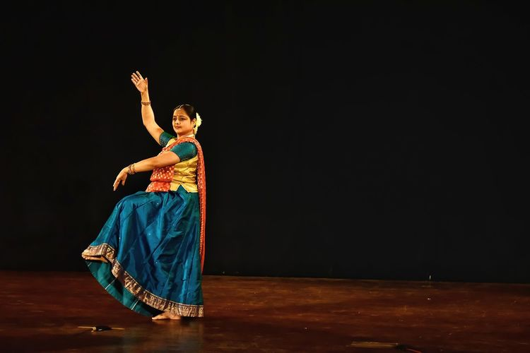 Woman performing kathak on stage
