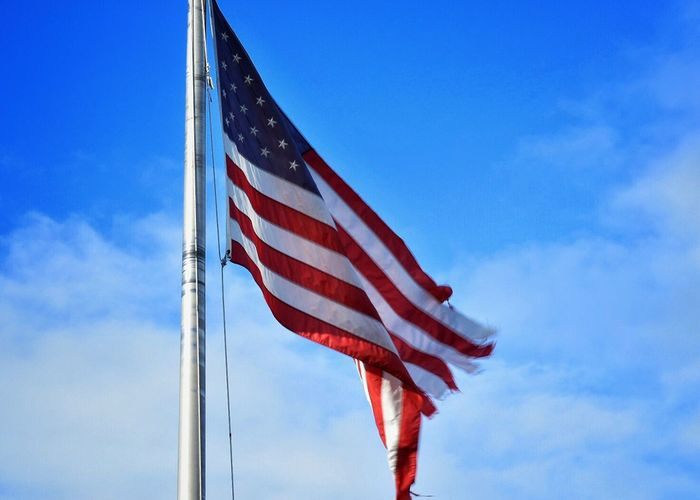 Patriotism Flag Cultures Striped Stars And Stripes Independence Sky Low Angle View Symbolism Outdoors National Icon No People Flag Pole Freedom Day Neglected Tattered Blowing In The Wind... Outdoor Photography Red White And Blue Red, White And Blue Flags In The Wind  USA United States