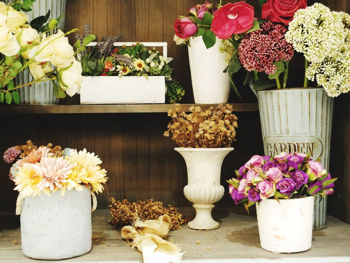 Close-Up Of Flowers In Vases