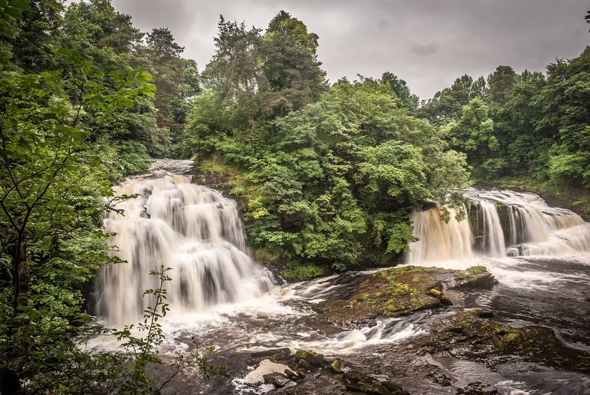 Eyeem Scotland  Waterfall Water Motion Tree Scenics Long Exposure Nature Beauty In Nature No People Cloud - Sky Sky Day Landscape Outdoors Growth Travel Destinations Power In Nature New Lanark