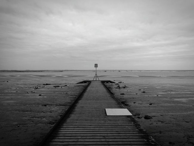 evening stroll down the front. shame about the plywood fix to the broken section Huwawei Huwawie P9 Beach Pier Monochrome Wood Oldandnew Beachphotography Beacon