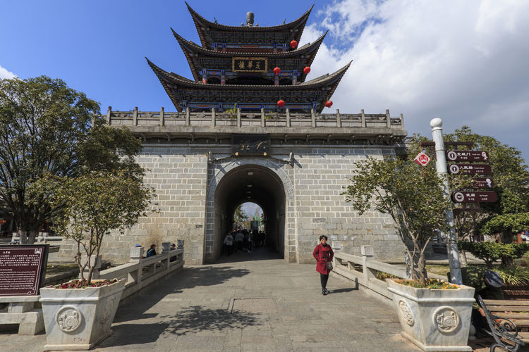 Dali, China - February 23, 2019: One of the main gates in Dali old town at noon Dali Yunnan China Yunnan Wall Tower Old Town Gate Architecture Built Structure Building Exterior Real People