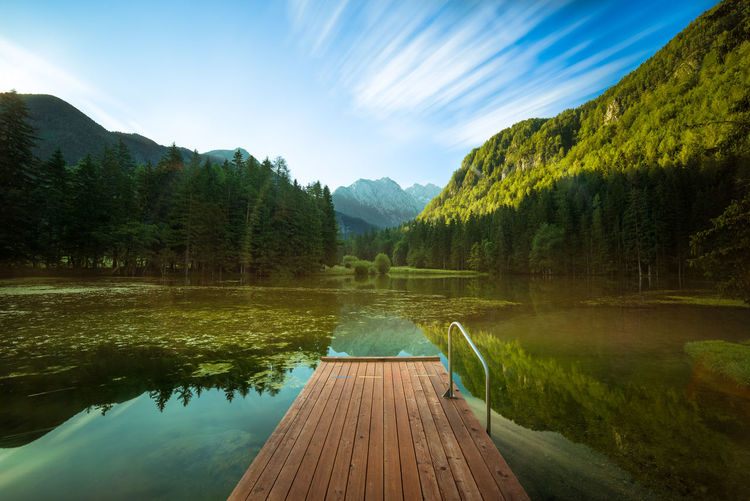 Plansarsko lake, Jezersko, Slovenia Pier Slovenia Beauty In Nature Cloud - Sky Day Growth Idyllic Jetty Lake Landscape Long Exposure Mountain Nature No People Outdoors Plant Reflection Scenics - Nature Sky Tranquil Scene Tranquility Tree Water Wood - Material
