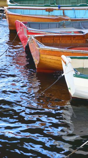 Close-up of boat moored in water
