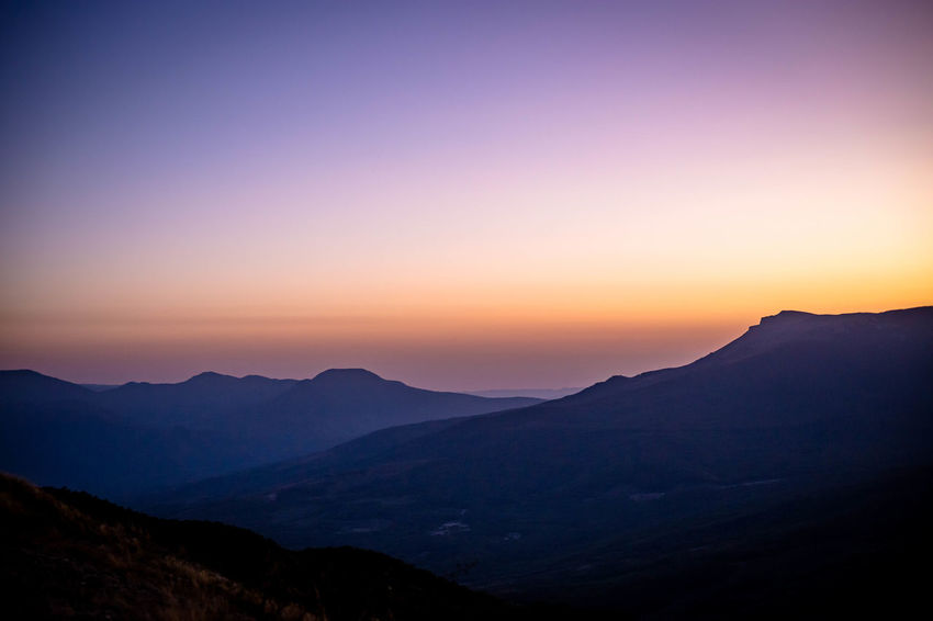 Beauty In Nature Clear Sky Day Landscape Mountain Mountain Range Nature No People Outdoors Scenics Silhouette Sky Sunset Tranquil Scene Tranquility