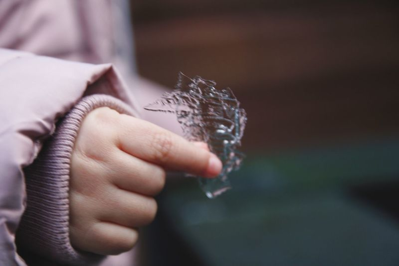 Midsection of child holding ice