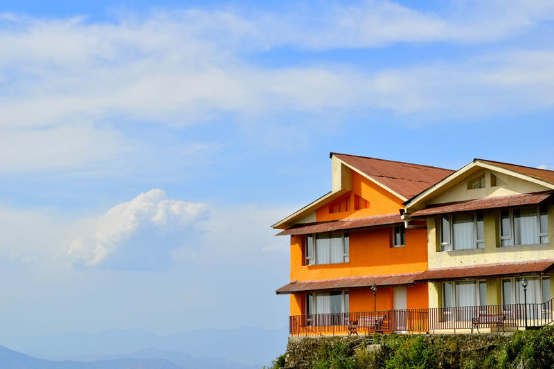 lets share a space...among the clouds...in an orange cove. Beauty In Nature Blue Skies Gun Hill Mussoorie NIKON D5300 Orange Outdoors Residential Structure Room With A View Swarna Deepak Photography Vibrance