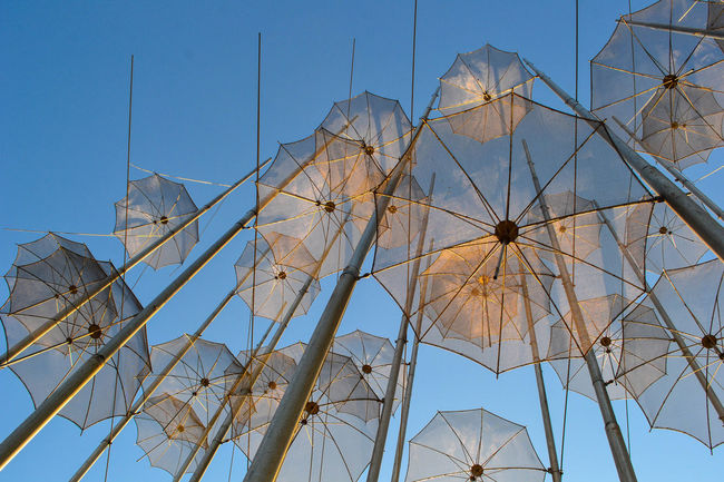 Umbrellas and sky Thessaloniki Salonicco Grecia Greece Umbrellas Umbrella Sky Blue Outdoors Arts Culture And Entertainment Day Art Streetphotography Arte Cielo Blu Azzurrro Minimalist Architecture Art Is Everywhere