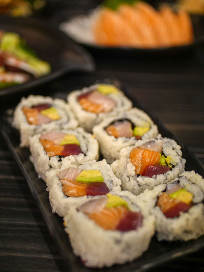 Avocado Restaurant Row Fish Vintage Style Retro Styled Wooden Table Black Blurred Background Sushi Japanese Food Japan Fried Egg Egg Yolk Vegetable Egg Fried Close-up Food And Drink Rice - Food Staple Salmon Salmon - Seafood Soy Sauce Japanese Culture Seafood Tuna Soybean Chopsticks Sashimi