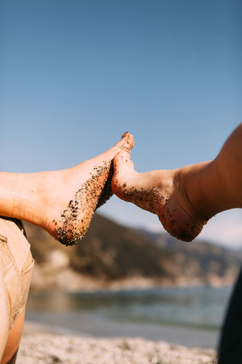 Beach Beauty In Nature Clear Sky Close-up Couple Day Feet Human Body Part Human Hand Italy Leisure Activity Lifestyles Love Men Nature Outdoors People Real People Relationship Sea Sky Sunlight Togetherness Two People Water An Eye For Travel #NotYourCliche Love Letter