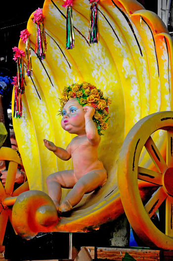 Inside the Mardi Gras Museum - New Orleans, USA EyeEm Gallery New Orleans EyeEm Baby In Shell Carriage Ride Day Indoors  Mardi Gras Museum One Person People Real People Shells Shirtless Yellow Paint The Town Yellow