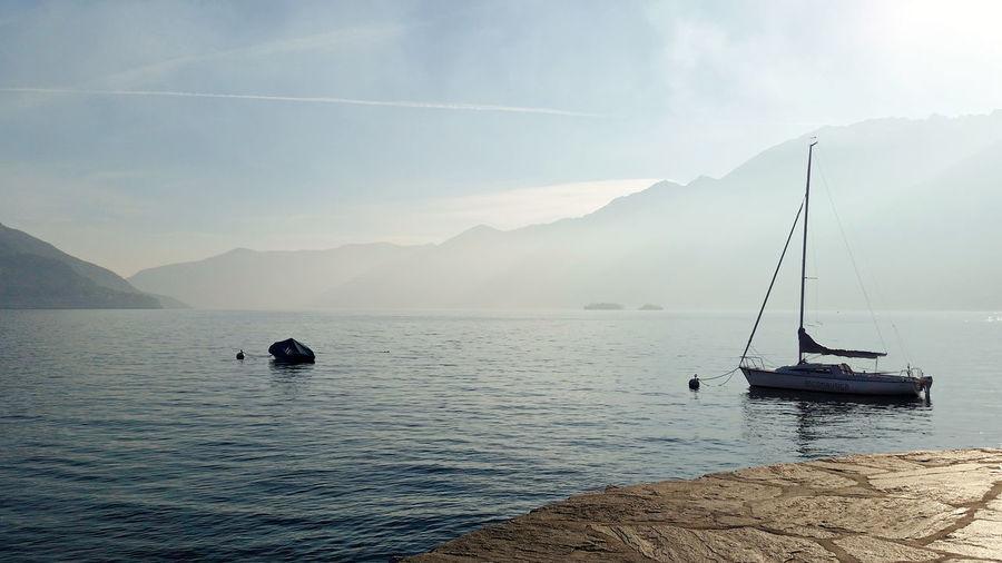 Scenic view of lake maggiore against sky