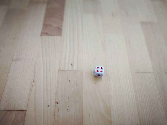 Dice on a wooden background. Education, chance, bet, play, and risk concept. Wood Still Life Play Dots Math Day Examination Numbers Concept Number Dice Indoors  RISK Mathematics Exam Education Chance Wooden Bet No People Numbers Only Risky Dices High Angle View Wood - Material Opportunity Leisure Activity Gambling Leisure Games Relaxation Indoors  Arts Culture And Entertainment Table Luck Flooring Human Body Part Hardwood Floor Playing White Color Shape Human Foot