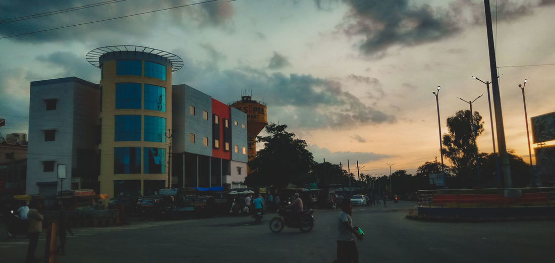 Panoramic view of street and buildings against sky at sunset