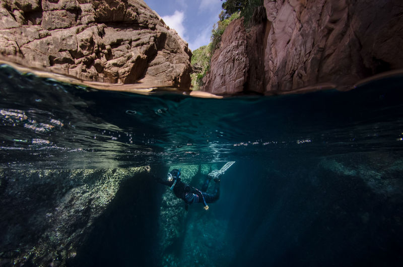 Freediver among beautiful rock formations Freediver Adventure Beauty In Nature Cave Diver Exploration Freediving Full Length Leisure Activity Nature One Person Outdoors People Real People Rock - Object Rock Formation Scuba Diver Scuba Diving Sea Sky Swimming UnderSea Underwater Vacations Water Breathing Space