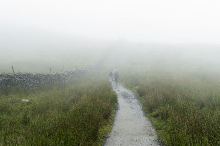 Footpath In Countryside In Foggy Weather