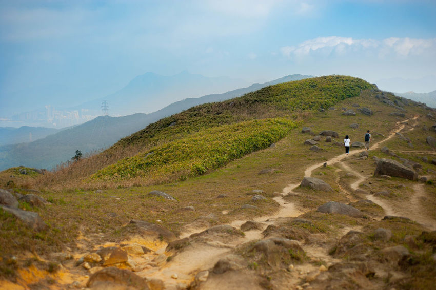 Hong Kong Sunny Blue Green Yellow Mountains Sky Serenity Nature_collection No People Beauty In Nature Scenics Landscape Hiking Outdoors Mountain Countryside Clouds And Sky Hill Grass Country Road Road Clear Sky Track And Field Tracks In The Sand