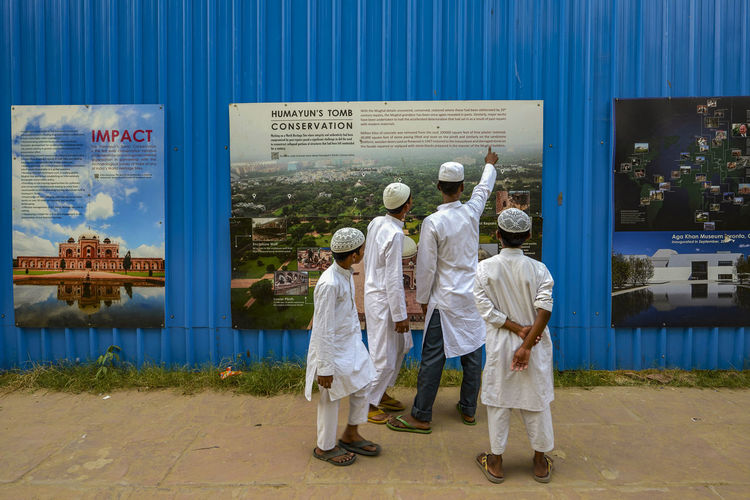 Muslim boys discussing together in front of a information board at Humayun mausoleum in Delhi First Eyeem Photo Architecture Pointing Board Information Rear View Boys Mausoleum Humayun Delhi India Outdoors Clothing Communication People Day Standing Group Of People Editorial Use Only