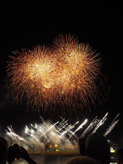 Amazing Experience Architecture Arts Culture And Entertainment Beautiful Colors Blurred Motion Building Exterior Celebration Event Exploding Firework Firework - Man Made Object Firework Display Glowing Illuminated Light Long Exposure Low Angle View Motion Nature Night Outdoors Sky Sparks