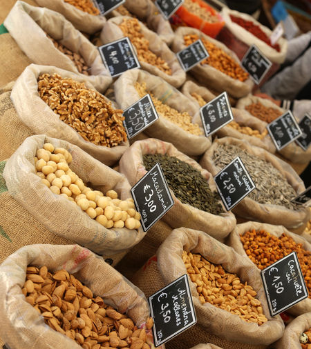 Abundance Choice Close-up Day Dried Food Dried Fruit Food Food And Drink For Sale Freshness Hazelnut Healthy Eating High Angle View Indoors  Large Group Of Objects Market Market Stall No People Nut - Food Peanut - Food Price Tag Retail  Sack Variation Walnut