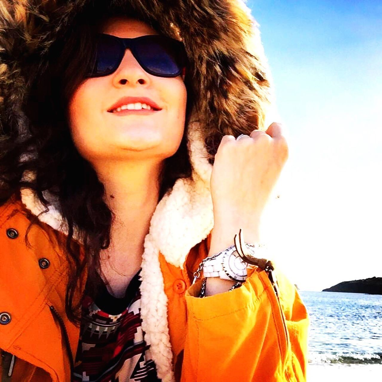 one person, sunglasses, young adult, portrait, smiling, beautiful woman, leisure activity, outdoors, young women, looking at camera, front view, real people, lifestyles, day, vacations, sunlight, one woman only, only women, confidence, sea, one young woman only, happiness, adults only, beach, beauty, adult, women, cheerful, sky, nature, people, water, close-up, beauty in nature