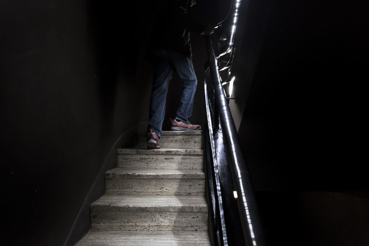 Staircase Steps And Staircases One Person Architecture Indoors  Dark Direction Human Body Part Railing Full Length Adult Low Section Emotion Men Copy Space Moving Up Standing The Way Forward Entrance Jeans Edificio Comega Comega Buenos Aires Buenos Aires, Argentina