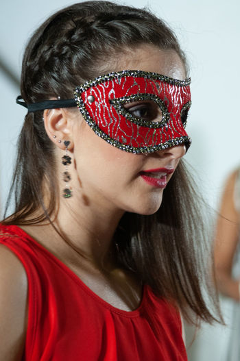 Close-up of young woman wearing eye mask