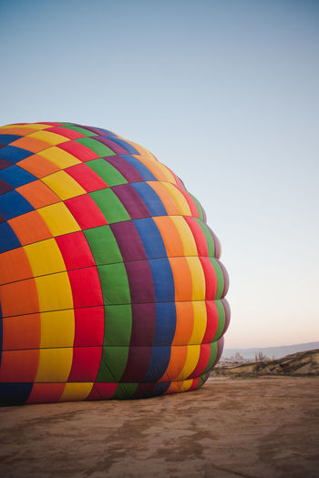 Multi colored hot air balloon on mountain
