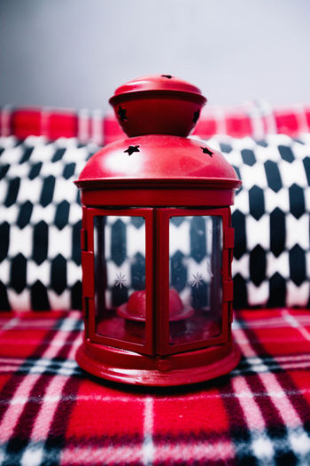 Close-up of lamp on sofa