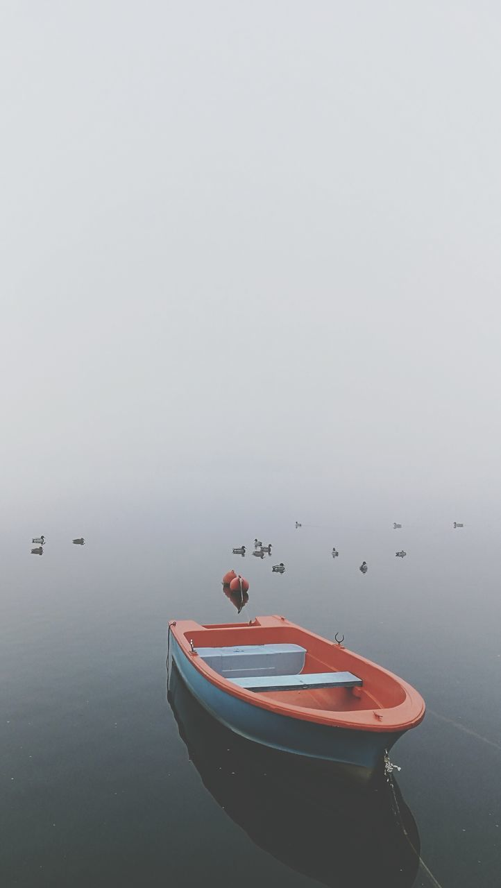 water, boat, nautical vessel, copy space, waterfront, no people, tranquility, nature, transportation, day, outdoors, fog, moored, red, lake, beauty in nature, scenics, sky