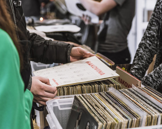 Used vinyls' market Beauty In Nature Buying Choice Close-up Cover Holding Human Hand Indoors  Man Made Object Market Men Paper People Rakovina Real People Sale Selection Sell Selling Vinyls Standing Vinyls Vinyls' Market Vinylshop Woman Portrait Working