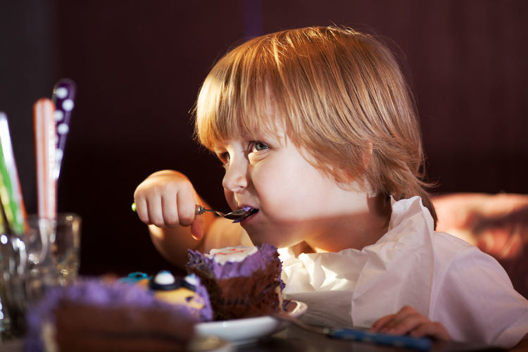 Baking Boy Cake Caucasian Celebration Child Childhood Chocolate Confectionery Dessert Dinner Horizontal Indoors  Kid Little Restaurant Table Young